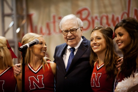 Warren Buffett sings with University of Nebraska cheerleaders during the Berkshire Hathaway Annual shareholders meeting in Omaha