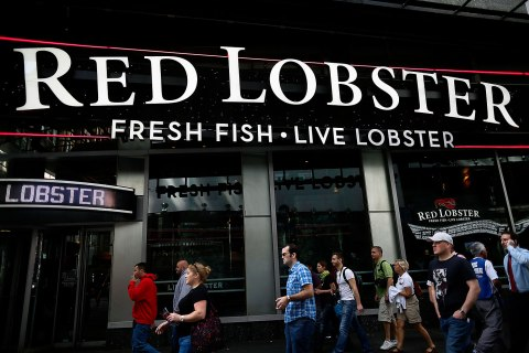 Pedestrians walk by a Red Lobster restaurant in Times Square in New York City on Sept. 19, 2012.