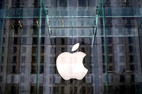 File photo of the Apple logo inside the glass entrance to the Apple Store on 5th Avenue in New York City