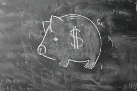 Piggy Bank Drawn on Blackboard
