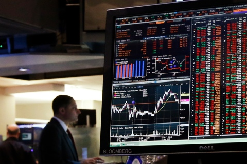A Bloomberg terminal displays news on the floor of the New York Stock Exchange in New York City,  on May 13, 2013.
