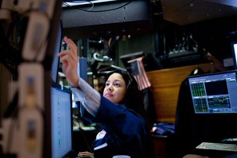 A trader works on the floor of the New York Stock Exchange in New York, U.S., on Monday, Jan. 3, 2012.