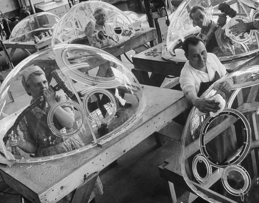 Workers making plexiglass domes for aircraft in 1945.