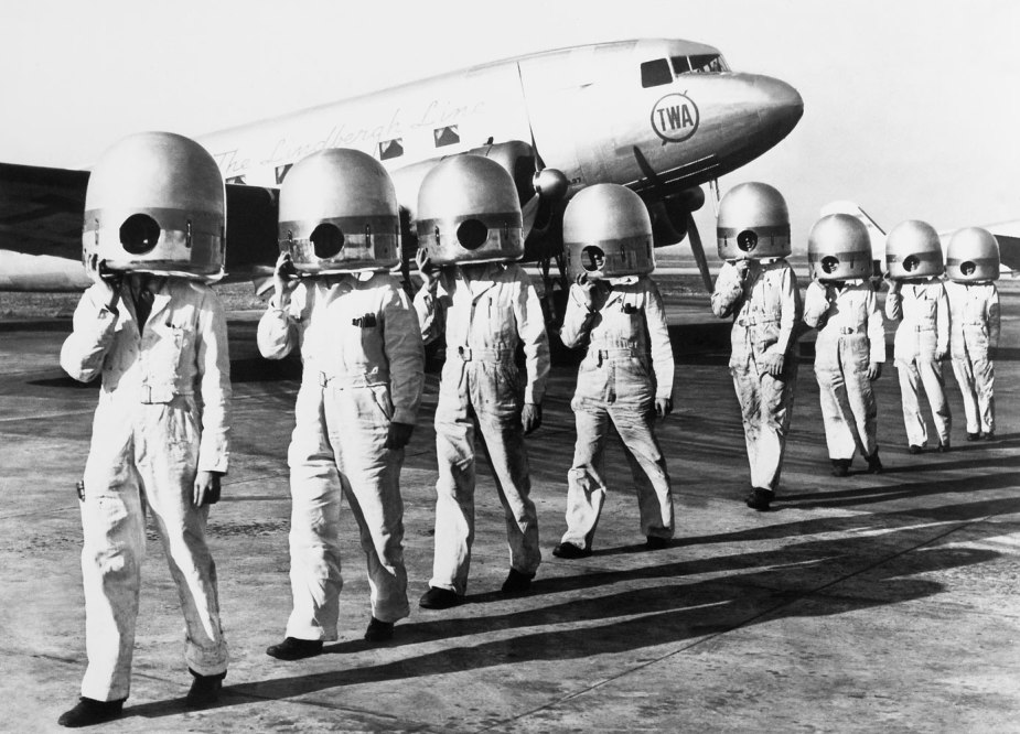American mechanics carrying casings on their heads in 1939.
