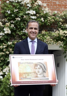 Governor of the Bank of England, Mark Carney holds the concept design for the new Bank of England ten pound banknote, featuring author Jane Austen, at the Jane Austen House Museum in Chawton, England on July 24, 2013.