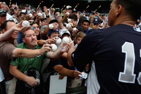 Fans clamour for an autograph from Alex Rodriguez #13 of the New York Yankees before a game against the Chicago White Sox at U.S. Cellular Field in Chicago, on Aug. 6, 2013.