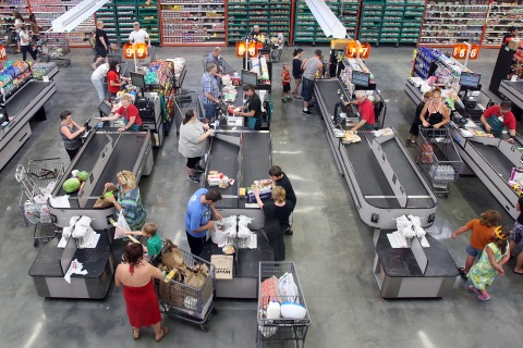 Customers bag their own groceries at checkout counters at WinCo Foods on Fairview Avenue in Boise, Idaho, on July 1, 2013.