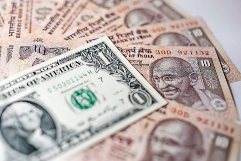 India Rupee And U.S Dollar Banknotes As The Reserve Bank Of India Attempts To Curb The Rupees Plunge