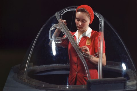 A woman completes work on bombardier nose section of B-17F navy bomber, better known as the 'Flying Fortress', at the Douglas Aircraft Company plant, in Long Beach, Calif., in 1942.