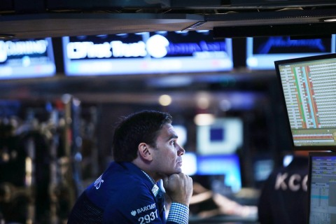 A trader works on the floor of the New York Stock Exchange (NYSE) in New York City, on Sept. 5, 2013.