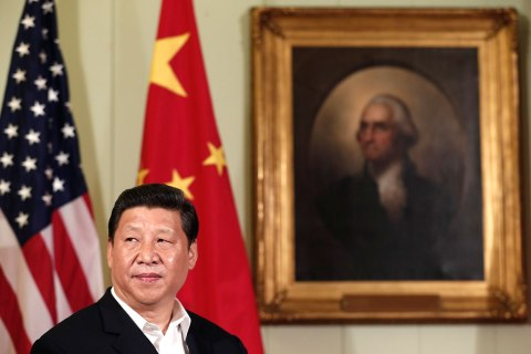 Chinese President Xi Jinping looks up as he and U.S. President Barack Obama speak to reporters in California
