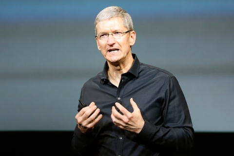 Apple Inc CEO Tim Cook speaks from the stage during Apple Inc's media event in Cupertino