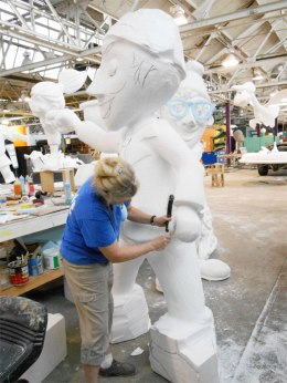 A Parade Company Artist sculpts a larger-than-life character for the Blue Cross Blue Shield of Michigan Path of Confidence float, in October 2013.