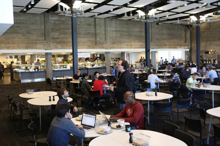 Twitter employees sit in a cafeteria at the company's headquarters in San Francisco