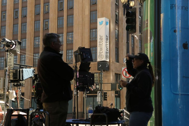 A television crew looks on outside Twitter's headquarters in San Francisco