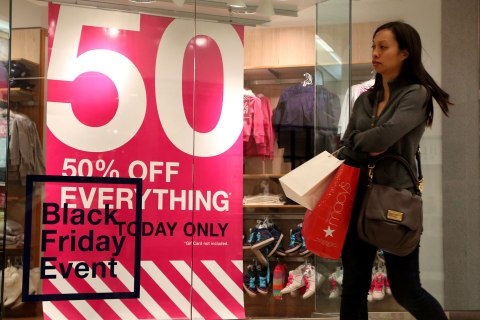 A Black Friday shopper walks past a Gap Kids store inside the Glendale Galleria in Glendale, California