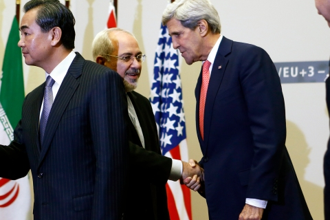 US Secretary of State Kerry shakes hands with Iranian Foreign Minister Zarif after a ceremony at the United Nations in Geneva