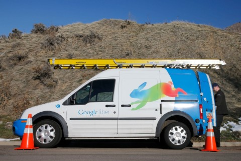 A Google Fiber technician gets supplies out of his truck to install Google Fiber in a residential home in Provo