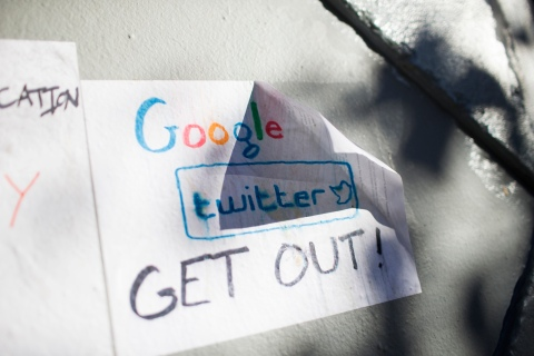 Signs in opposition of technology companies are seen in San Francisco