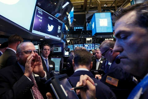 Traders get to work during Twitter's IPO on the floor of the New York Stock Exchange in New York Nov. 7, 2013.